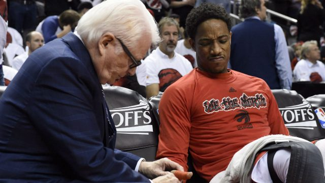 Toronto-Raptors'-sports-science-director-Alex-McKechnie-(left)-works-on-Raptors'-DeMar-DeRozan's-thumb-before-Eastern-Confernce-semifinal-NBA-playoff-game-against-the-Miami-Heat-in-Toronto-on-Sunday,-May-15,-2016.-(Frank-Gunn/CP)