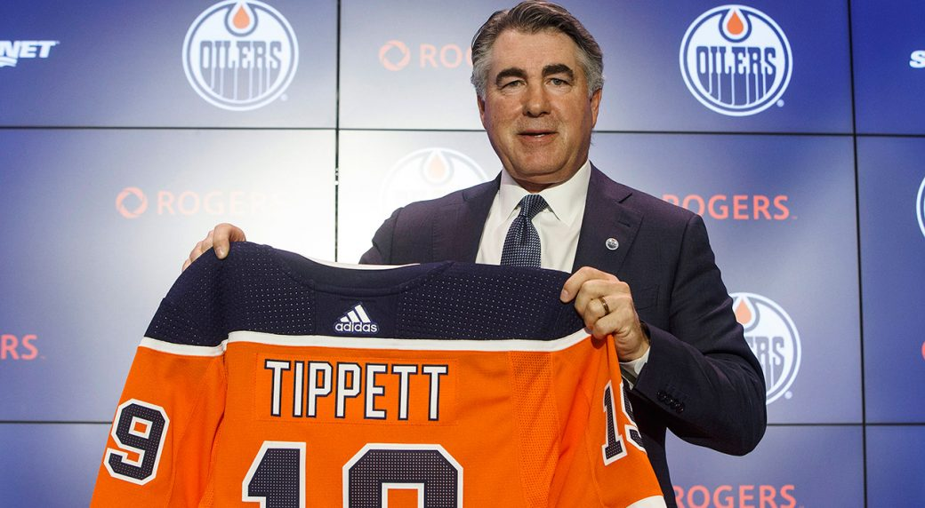 oilers-coach-dave-tippett-holds-up-a-jersey