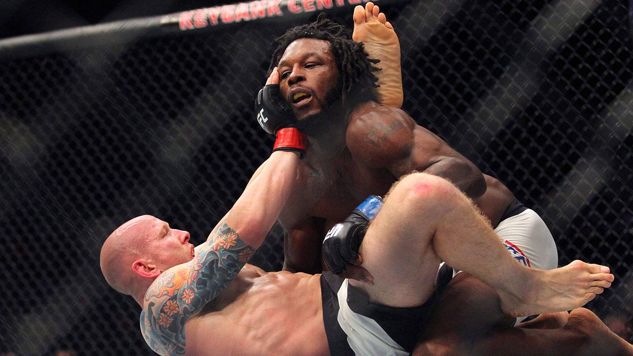 Josh-Emmett-taken-down-by-Desmond-Green-at-UFC-210