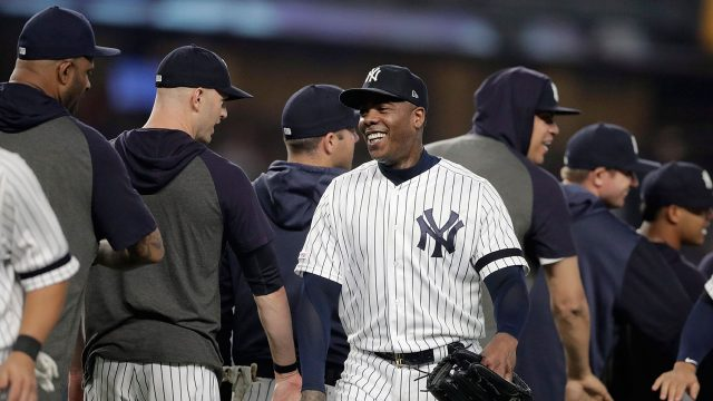 MLB-Yankees-Chapman-celebrates-with-team-after-win