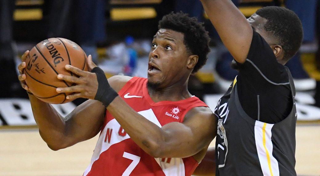 NBA-Raptors-Lowry-drives-against-Warriors-Looney