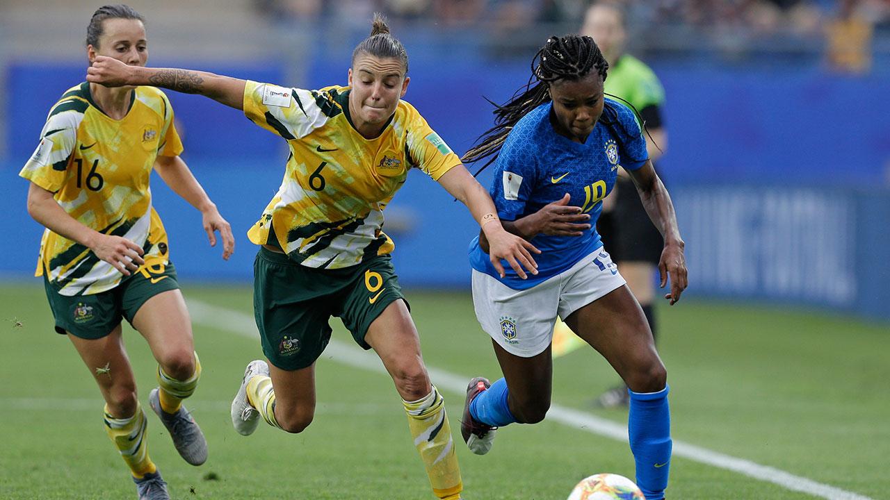 Soccer-Australia-controls-ball-against-Brazil