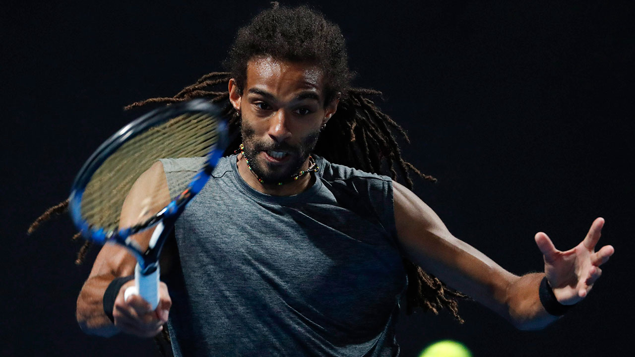 Tennis-ATP-Brown-hits-return-shot-at-Australian-Open