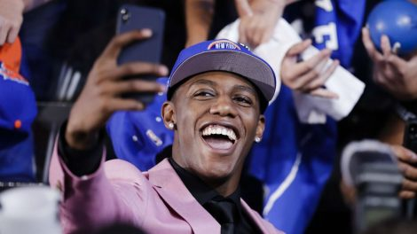 RJ-Barrett-poses-for-selfies-with-fans-after-he-was-selected-by-the-New-York-Knicks-at-the-NBA-basketball-draft-Thursday,-June-20,-2019,-in-New-York.-Barrett-was-selected-third-overall.-(Julio-Cortez/AP)