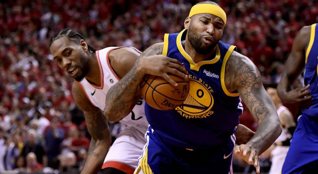 Toronto-Raptors-forward-Kawhi-Leonard-(2)-pushes-off-Golden-State-Warriors-centre-DeMarcus-Cousins-(0)-during-second-half-basketball-action-in-Game-5-of-the-NBA-Finals-in-Toronto-on-Monday,-June-10,-2019.-(Frank-Gunn/CP)