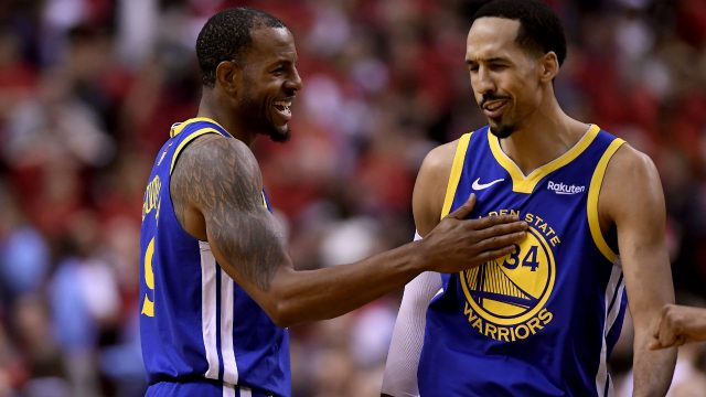 Golden-State-Warriors-forward-Andre-Iguodala-(9)-and-teammate-Shaun-Livingston-(34)-celebrate-their-win-following-second-half-Game-2-NBA-Finals-action-against-the-Toronto-Raptors,-in-Toronto-on-Sunday,-June-2,-2019.-(Frank-Gunn/CP)