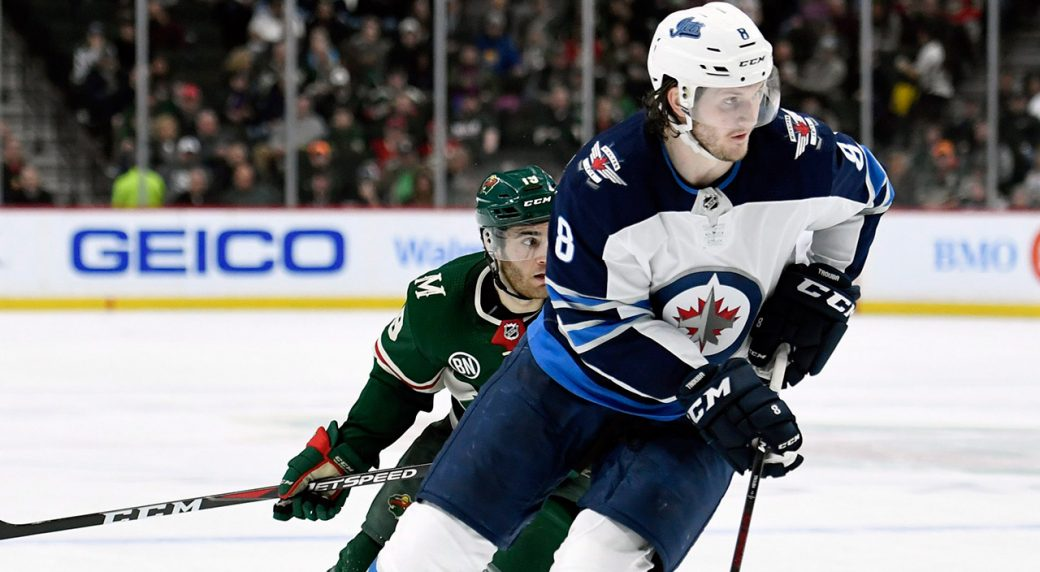 jets-defenceman-jacob-trouba-skates-with-puck-against-wild