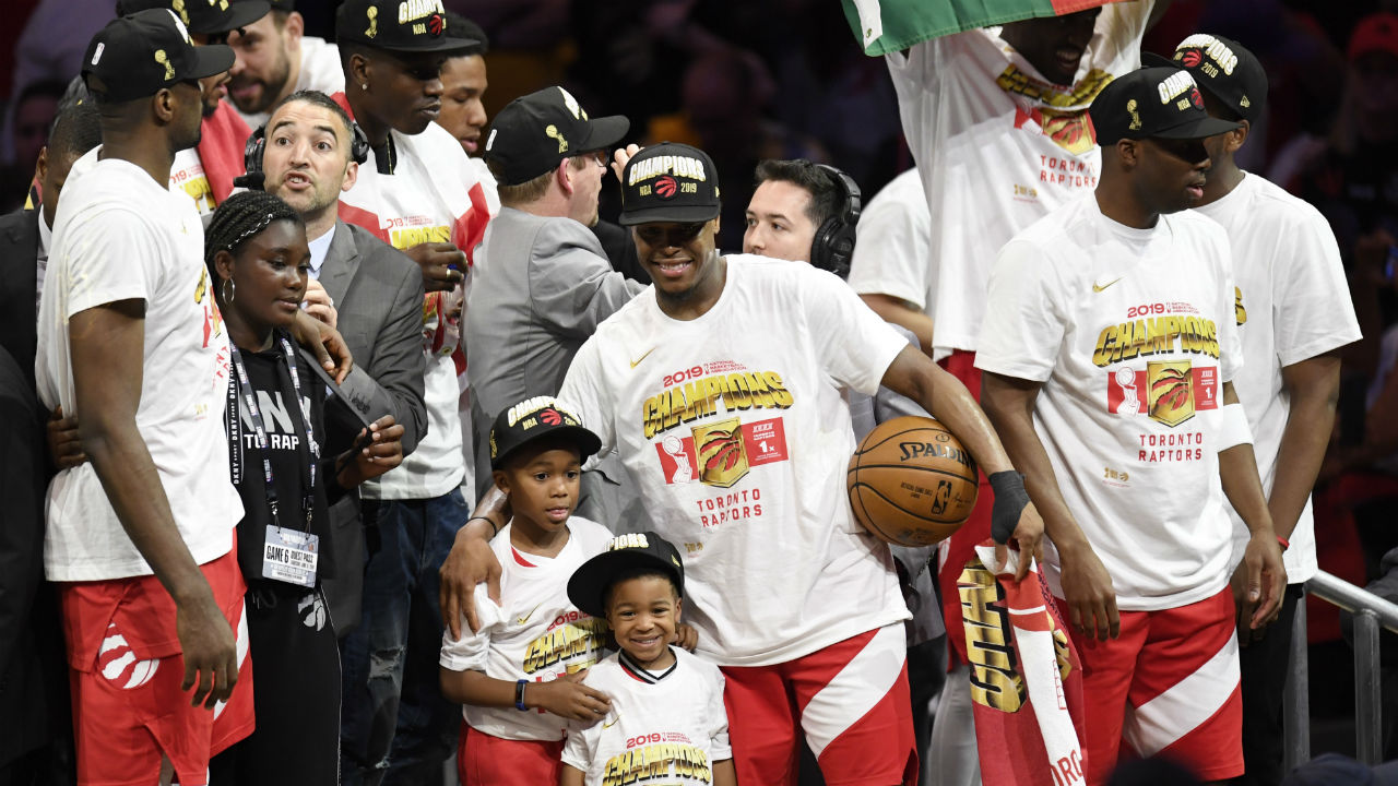 oronto-Raptors-guard-Kyle-Lowry,-centre,-celebrates-with-his-sons-after-defeating-the-Golden-State-Warriors-basketball-action-in-Game-6-of-the-NBA-Finals-in-Oakland,-Calif.-on-Thursday,-June-13,-2019.-Raptors-have-won-their-first-NBA-title-in-franchise-history.-THE-CANADIAN-PRESS/Frank-Gunn
