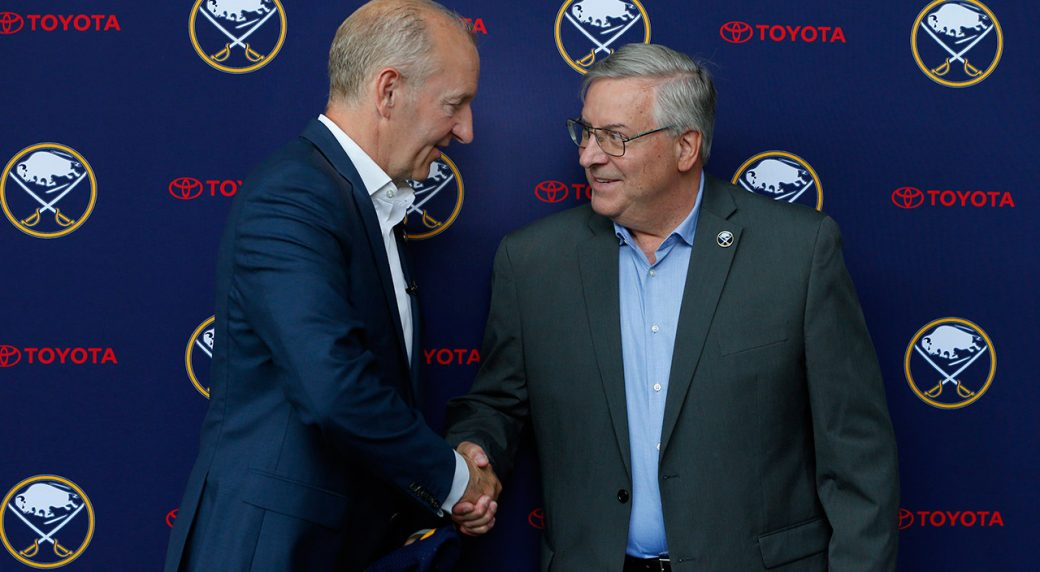 sabres-head-coach-ralph-krueger-shakes-hands-with-owner-terry-pegula