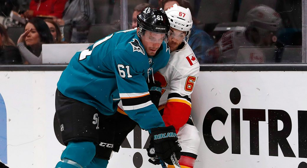 sharks-justin-braun-defends-against-flames-michael-frolik