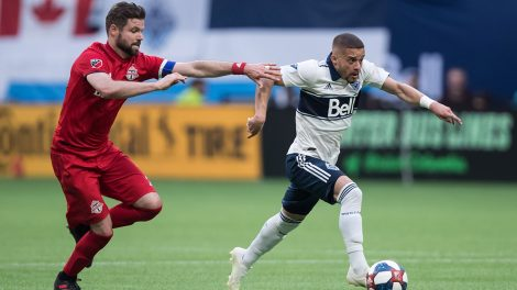 whitecaps-lucas-venuto-runs-with-ball-from-tfcs-drew-moor