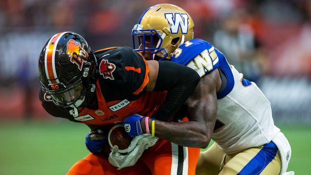 CFL-Bombers-Alexander-makes-tackle