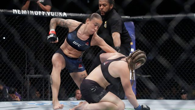 Herb-Dean-grabs-Germaine-de-Randamie-after-she-punches-Aspen-Ladd
