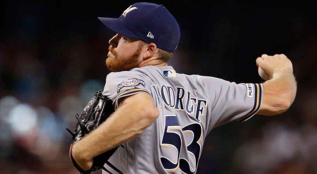 MLB-Brewers-Woodruff-throws