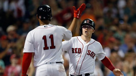 MLB-Holt-celebrates-with-Devers