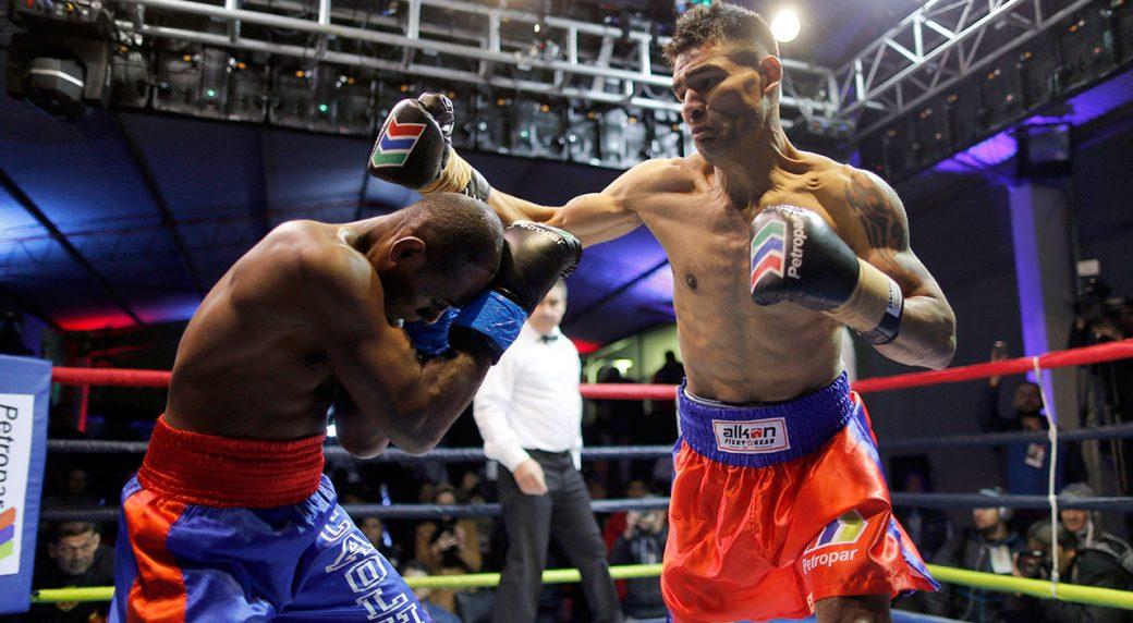 Paraguayan-boxer-Richard-Moray-punches-Carlos-Santos-de-Jesus-during-prison-tournament