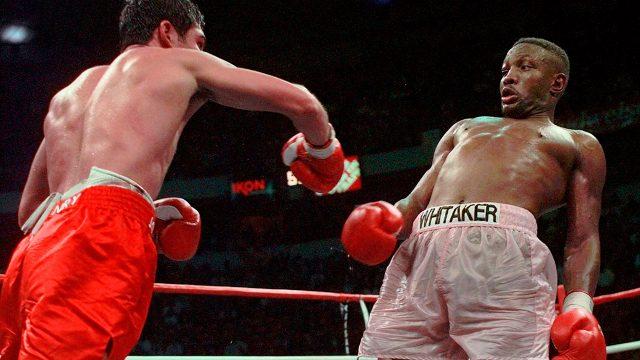 Pernell-Whitaker-leans-away-from-Oscar-De-La-Hoya-punch