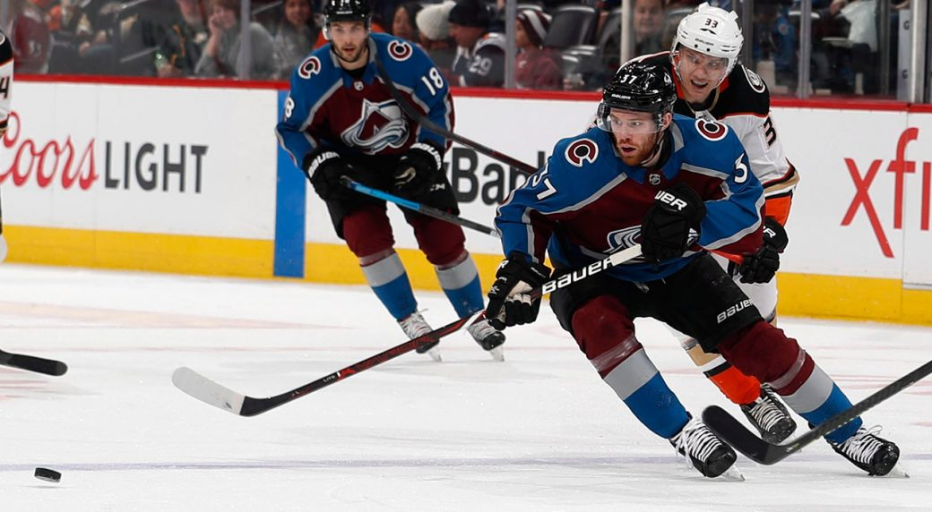 avalanche-winger-jt-compher-pursues-puck-against-ducks