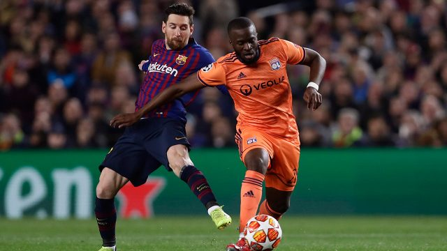 tanguy-ndombele-battles-for-ball-against-lionel-messi