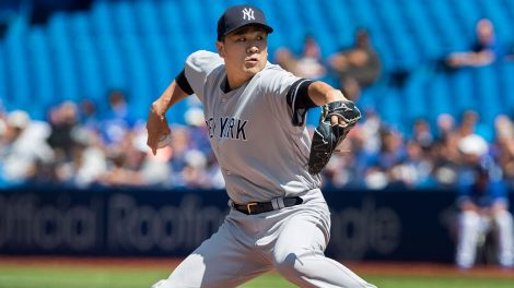 MLB-Yankees-Tanaka-throws-against-Blue-Jays