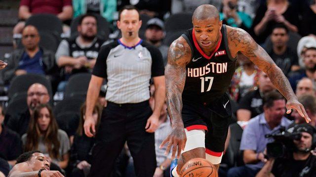 NBA-Rockets-Tucker-dribbles-against-Spurs