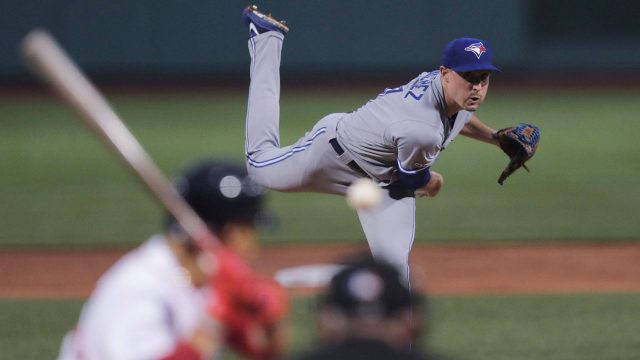 aaron-sanchez-winds-up-to-throw-pitch