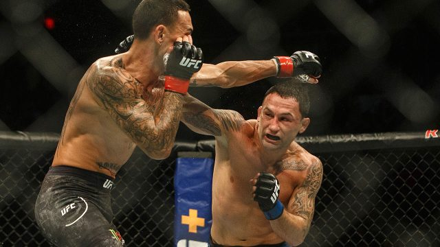 frankie-edgar-punches-max-holloway-at-ufc-240