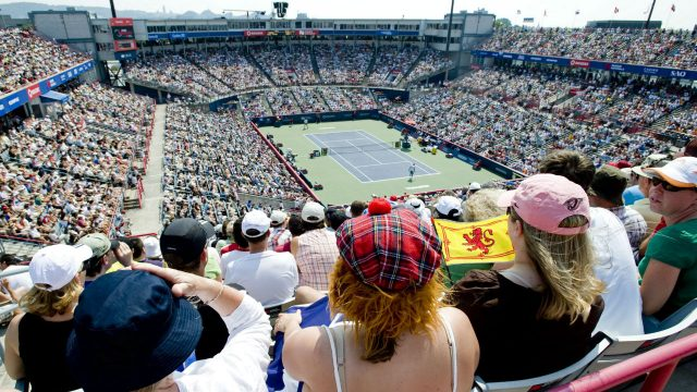 Fans-of-Britain's-Andy-Murray-watch-his-match-against-Argentina's-Juan-Martin-Del-Potro-during-the-final-of-the-Rogers-Cup-tennis-tournament-in-Montreal,-Sunday,-Aug.-16,-2009.