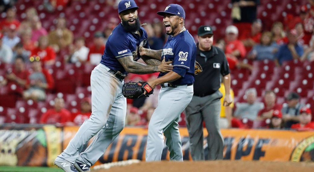 Surging Brewers clinch playoff berth with 9-2 win over Reds