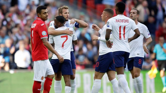 englands-harry-kane-celebrates-goal-with-teammates