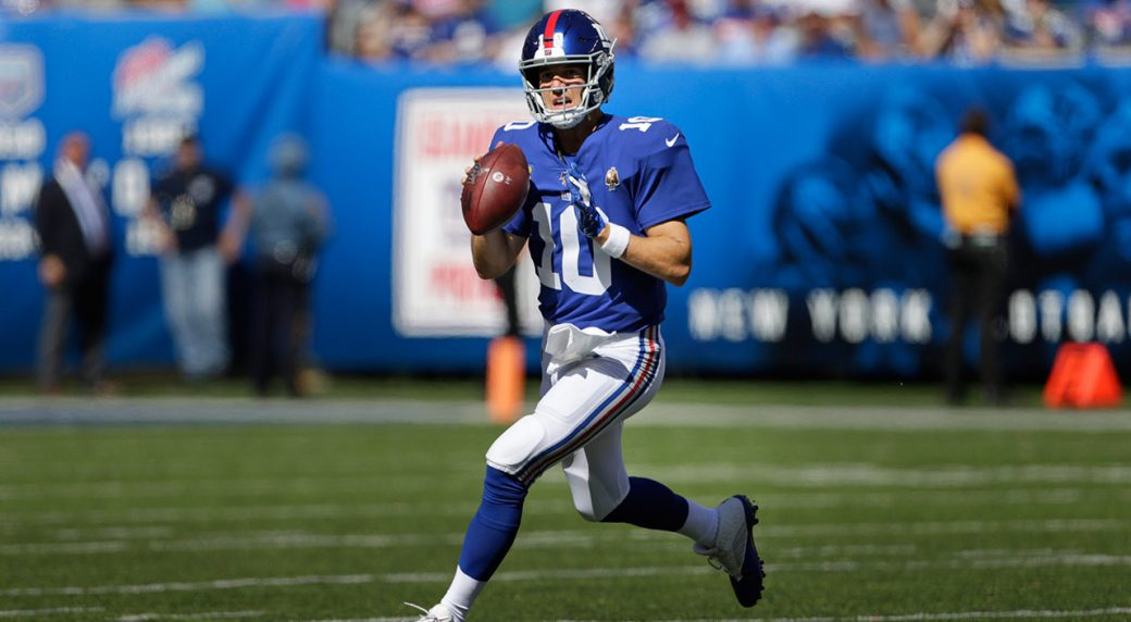 giants-eli-manning-looks-to-pass-against-bills