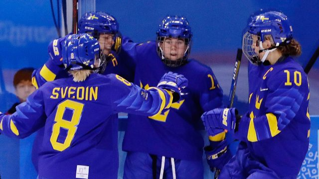 players-from-swedens-womens-hockey-team-celebrate-goal-at-olympics