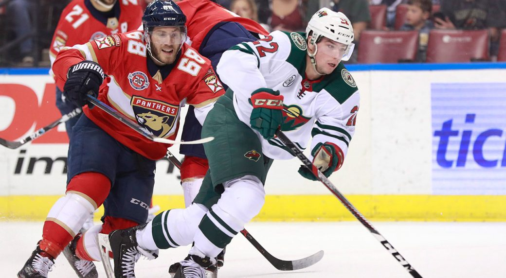wilds-kevin-fiala-battles-for-puck-with-panthers-mike-hoffman