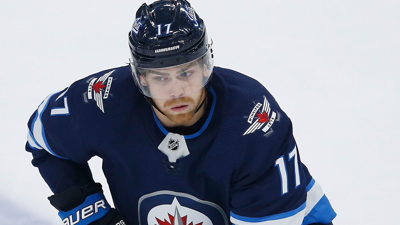 Jets' Adam Lowry forced out of game vs. Maple Leafs with injury