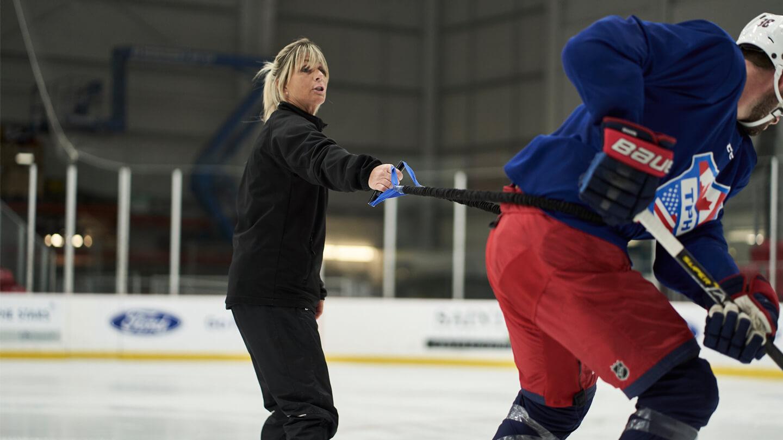 skating-coach-dawn-braid-runs-a-client-through-a-drill