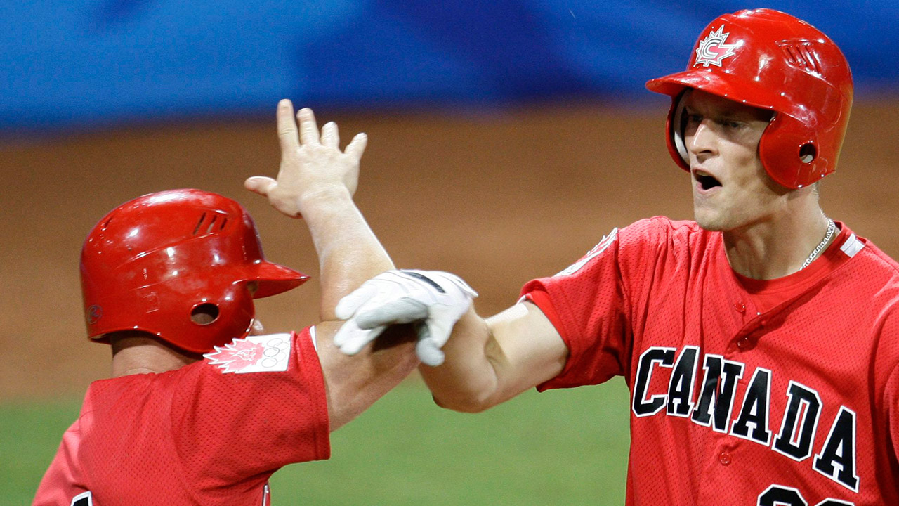 canadas-michael-saunders-celebrates-with-stubby-clapp-at-olympics