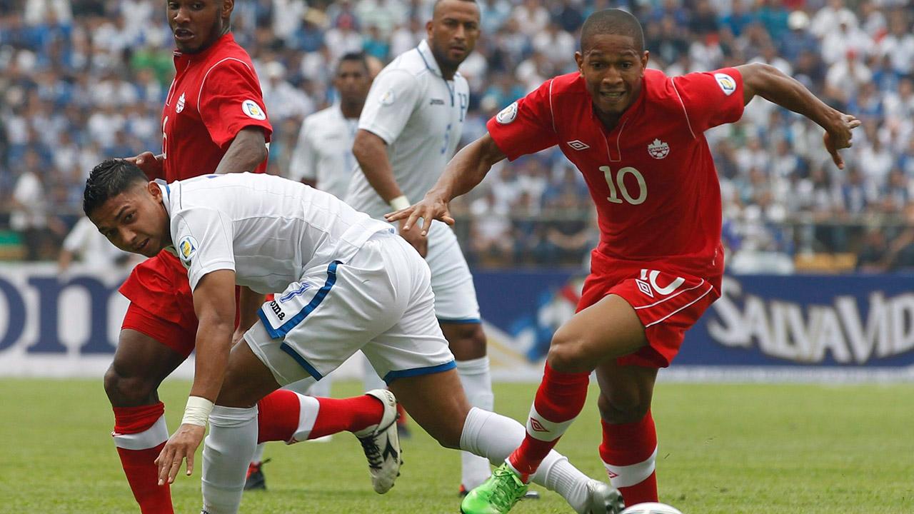 Canadas-simeon-jackson-battles-for-ball-against-honduras
