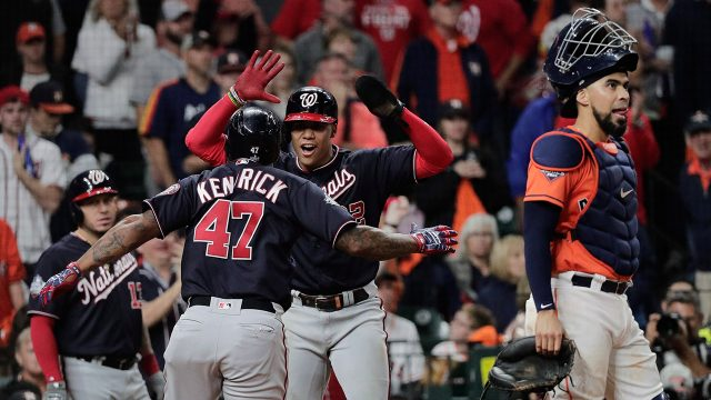 nationals-howie-kendrick-celebrates-home-run-with-juan-soto