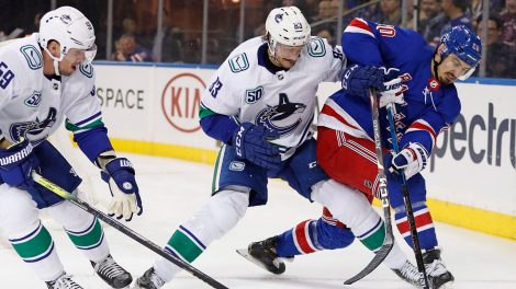 rangers-chris-kreider-battles-canucks-jay-beagle-and-tim-schaller