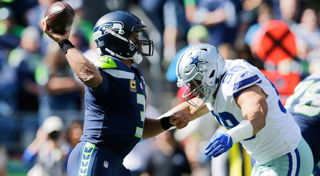 seahawks-russell-wilson-throws-as-cowboys-tyrone-crawford-attempts-tackle