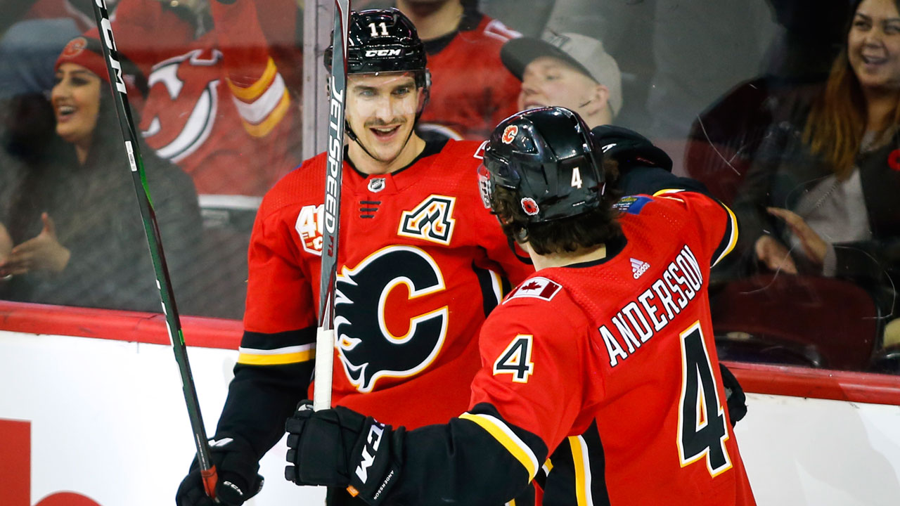 Hanifin's three point night helps Flames top the Devils