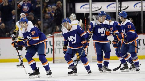 islanders-scott-mayfield-celebrates-goal-with-teammates