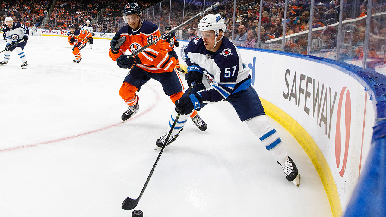 jets-gabriel-bourque-skates-with-puck-against-oilers