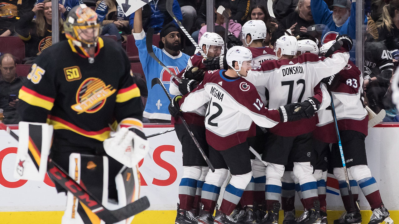 Canucks come back late and grab a much needed point against the surging Avalanche