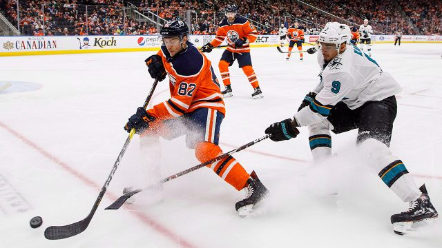 oilers-caleb-jones-and-sharks-evander-kane-battle-for-puck