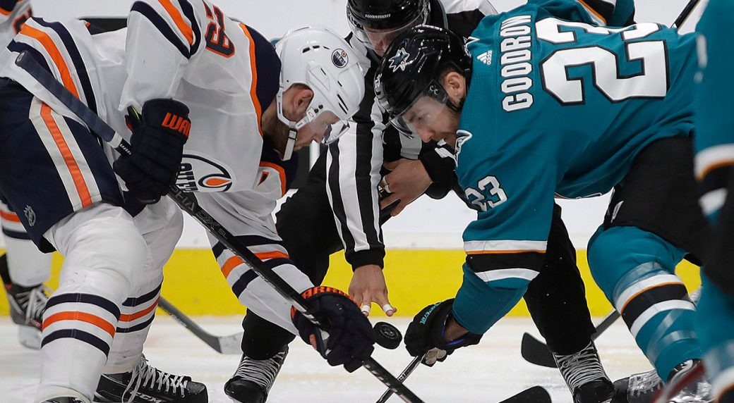 oilers-leon-draisaitl-and-sharks-barclay-goodrow-take-faceoff