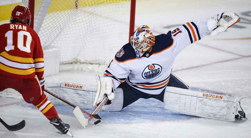 oilers-mikko-koskinen-makes-save-against-flames