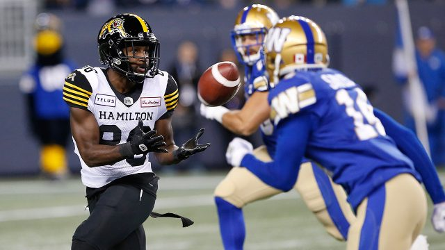 tigercats-bralon-addison-catches-pass-against-blue-bombers