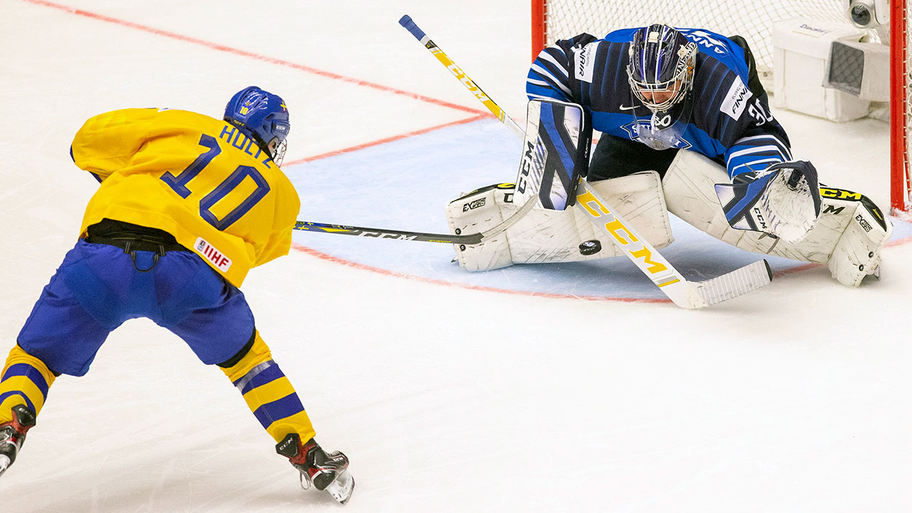 Swedes top the defending champ Finns in O.T. thriller