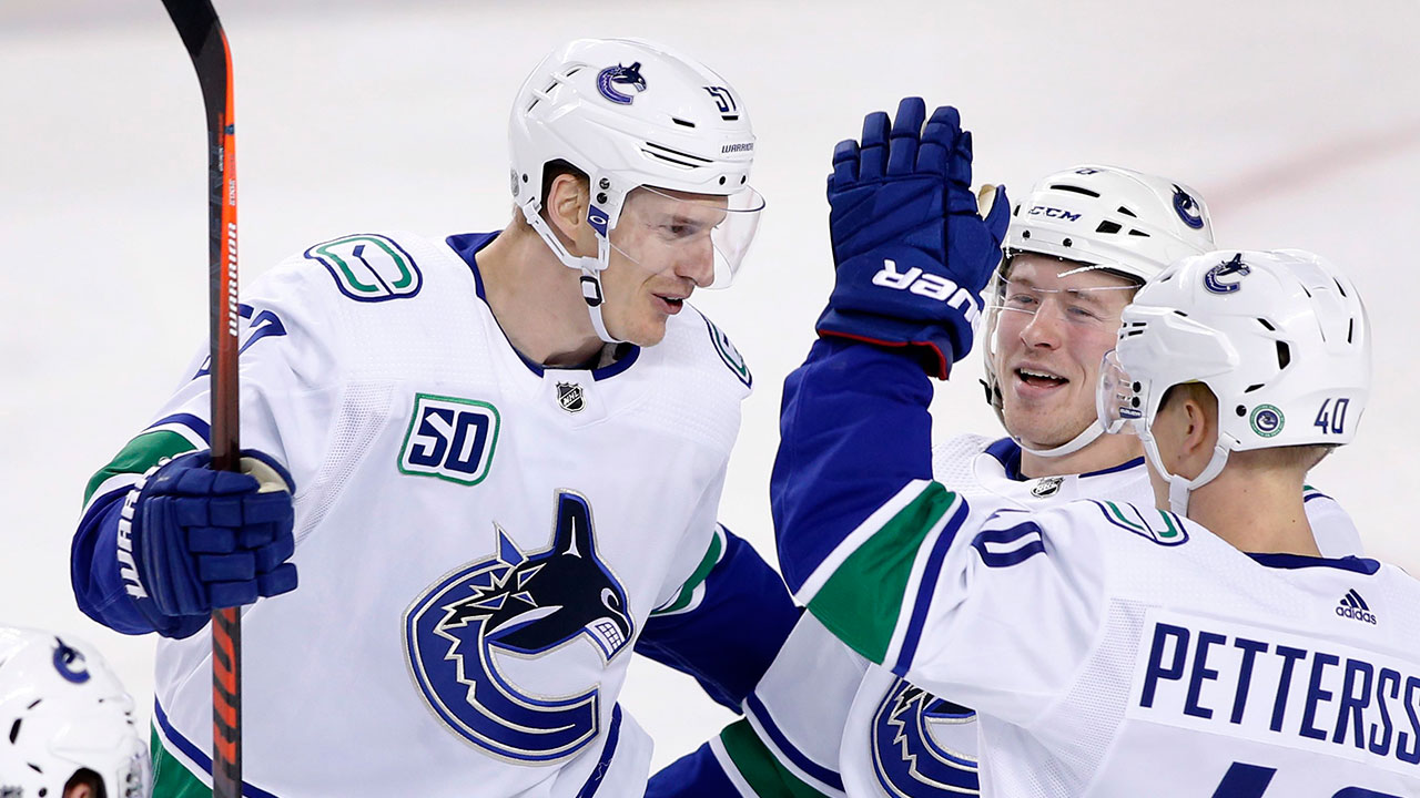 Canucks beat Calgary and take over 2nd in the Pacific